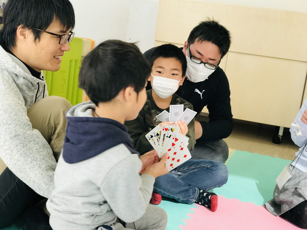 "Elementary Kids Playing ""Go Fish"""