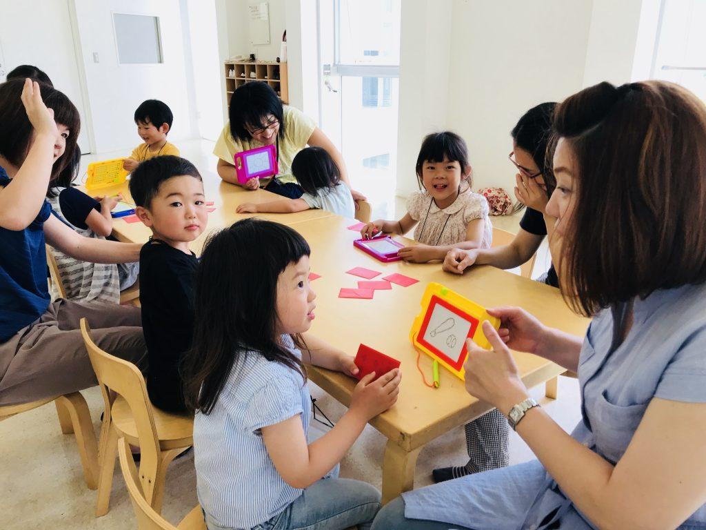 "Kindergarten Kids Playing ""Pictionary"""